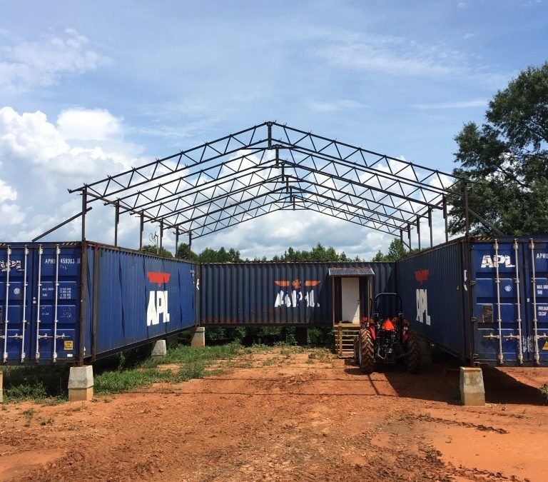 Shipping Container House – Assembling and installing the trusses.